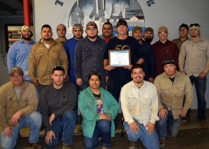 Kenny Moore with his Welding class
